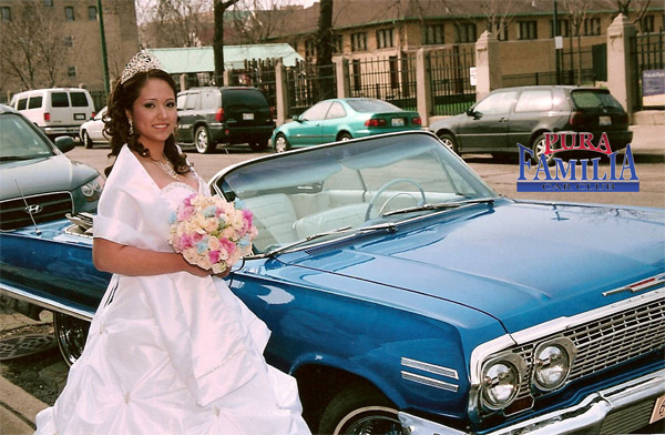 Cynthia's quinceanera by her 63 Impala convertible.