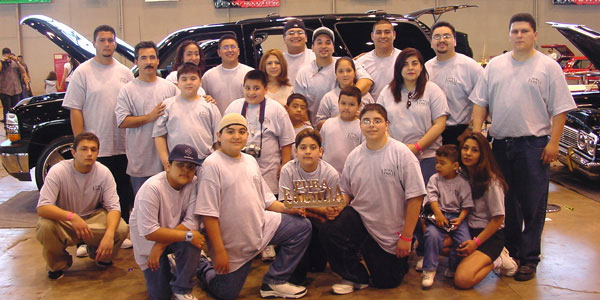 Pura Familia Car Club at a show.